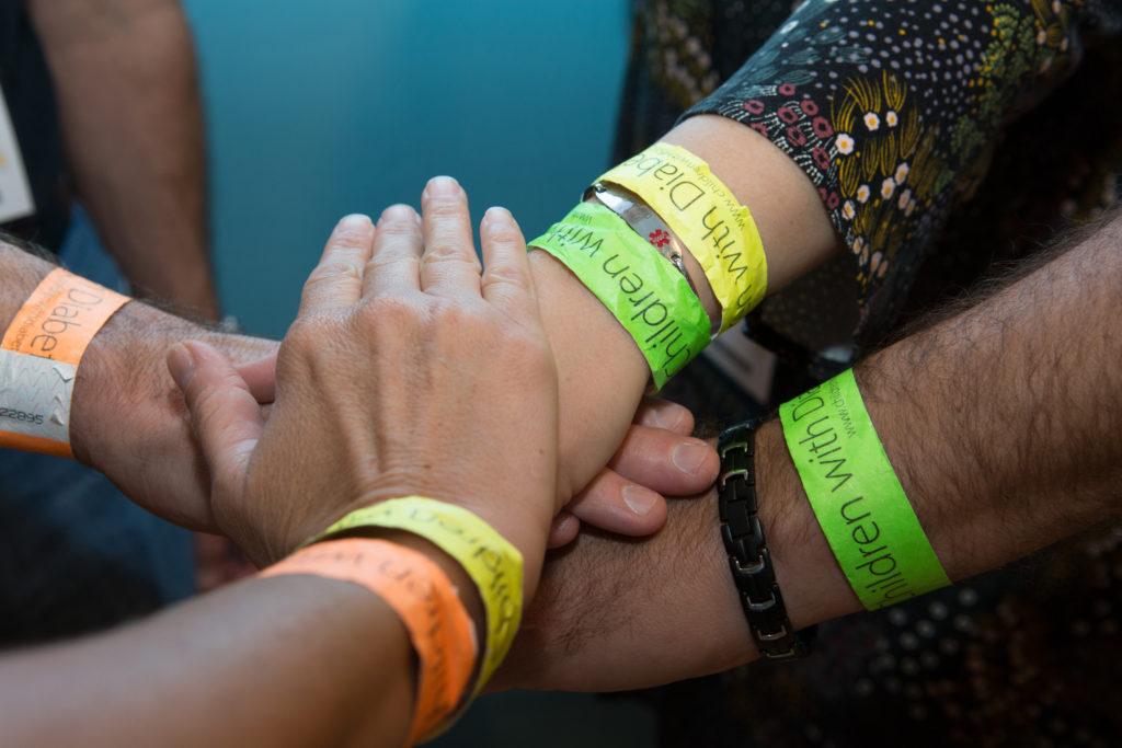 green bracelet orange bracelet group photo