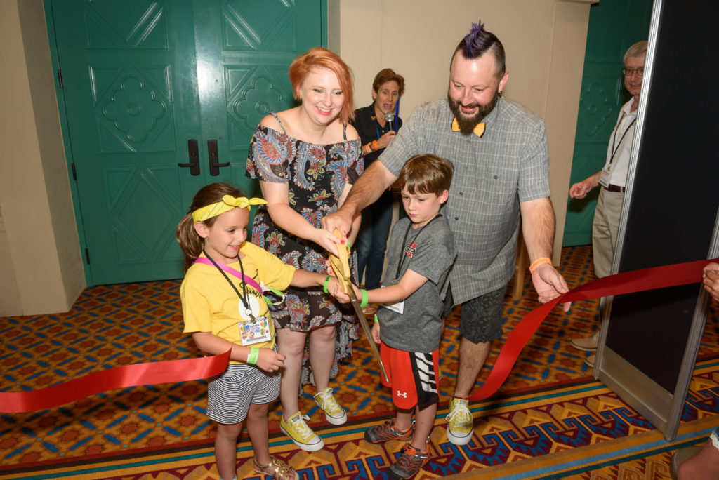 Amanda Jo and Billy Lee helped Isabella and Jackson cut the ribbon to open the Exhibition Hall on Wednesday