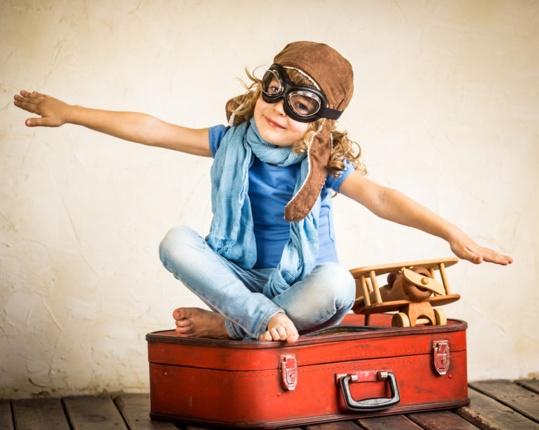 travel_girl_on_suitcase